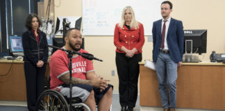 Andrew Meas, a research participant at UofL with a complete spinal cord injury, with members of the resarch team, Claudia Angeli, Susan Harkema and Enrico Rejc,.