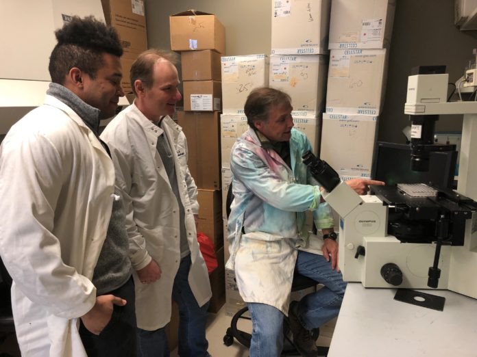 University of Louisville associate professor of pharmacology and toxicology Dr. Geoffrey Clark (far right) is co-inventor of a drug that may inhibit a critical cancer pathway.
