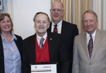 Larry Tyler, center, was recently recognized for 55 years of teaching in the Speed School.